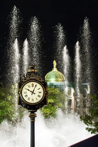 Clock with fountain behind