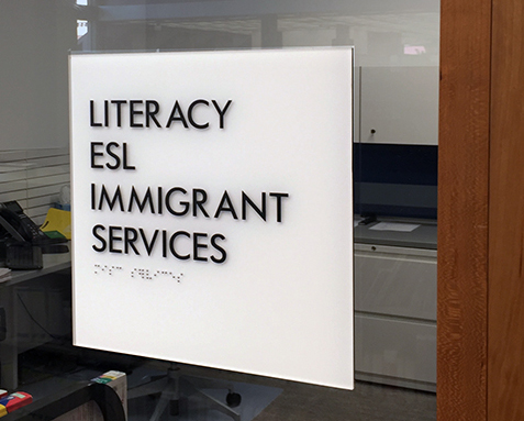 Literacy and Immigrant Services Sign Downtown Central Library CROP SM