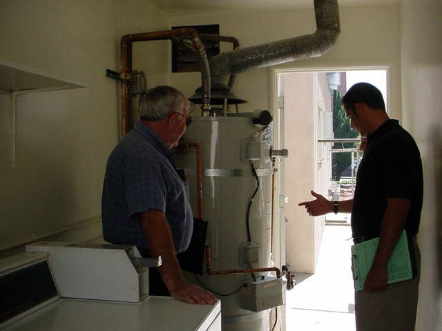 Code Enforcement Officer inspecting a water heater